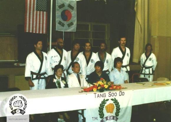 The founder's visit to US Region 9 in 1979. Sitting from the left: Mrs. Hwang Kee, Founder, CS Kim (2457), JS Lee (). Standing from left: Vic Martinov (10189), Geroge Page (11772), Fred Kenyon (14345), Andy Ah Po (10187), Llyod Francis (12924), Ted Mason (12895), and Terry Updike (18480).