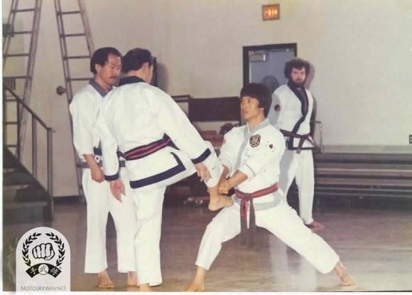 The founder's clinic in Detroit, MI in 1976. From left; HC Hwang (509), The Founder, CS Kim (2457), and Russ Hanke (4137).