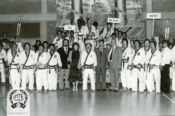 Group photo after ending ceremony at the 3rd Internationals in Watford, England. Yong Ki Hong (9193), Chun Sik Kim (2457), Eung Kyo Han (1369), HC Hwang (509), Kang Uk Lee (70), Dong Mun Kim (3167), Pal Yong Lee (549), Stephen Coleman (17656), Anthony Ooi (16518), George Wilson (20501), Louis Loke (23436), A Metaxas (20680), George Page (11772) are in the standrole.