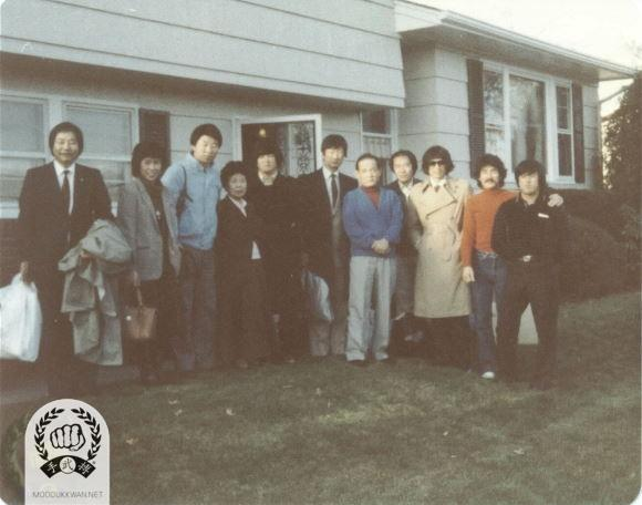 Instructors who attended for the 4th Internationals in 1982. They took a photo at in front of Founder's resident. From left: Kang Uk Lee (70) and his wife from England, Beom Ju Lee (11870), Mrs. Hwang Kee, Kyong Ahn Choi (4661) from Denmark, Hong Rae Kim (8914) from Ruxemberg, The founder, Young Ki Hong from USA, Khun Hwa Lee from Greece (8321), Hyuk Yoon Kwon () and Yong Jin Kim (17331) from Korea.