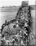 1950_Refugees with bomded bridge.jpg