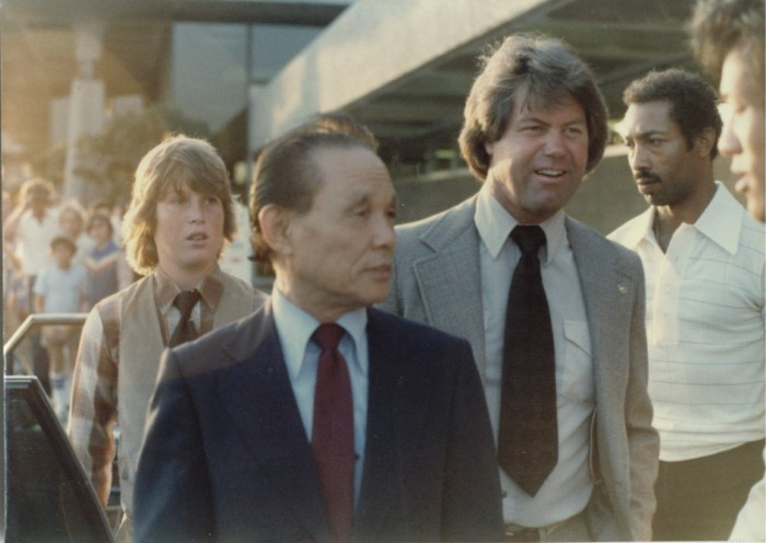 Fred Kenyon, Sa Bom Nim escorting Moo Duk Kwan founder Hwang Kee during a visit to California