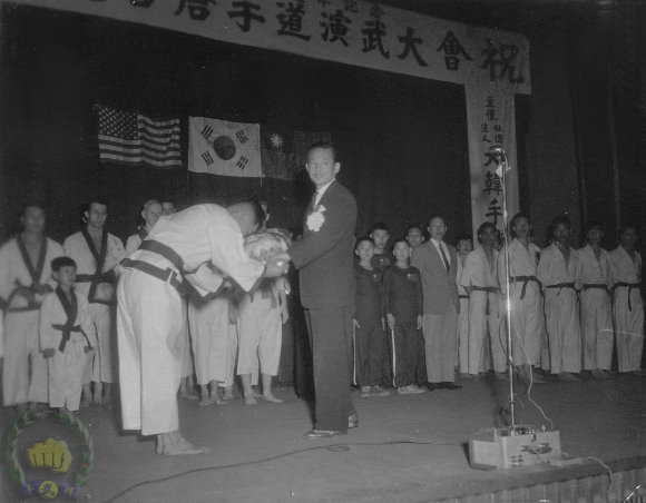 Founder receives flowers from his student at the 15th anniversary celebration