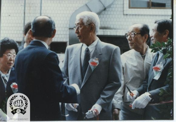 Grand Opening for the New Central Do Jang of Korean Soo Bahk Do Association, Moo Duk Kwan in Nam Young Dong, Yong San Ku, Seoul in May 1988. The founder is meeting with Professor Na, Hyun Seong who introduced Moo Yei Do Bo Tong Ji to the Founder for the first time.