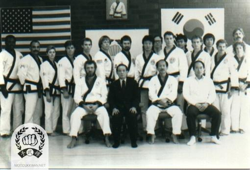 The 1988 Ko Dan Ja Shim Sa at US Hqrs. Do Jang in Springfeidl, New Jersey. Seating from left: Russ Hanke (4147), Founder, HC Hwang (509), YK Hong (4142). Standing from left: Greg Puriefoy (20724), Wm Diaz (20603), Sue Robin (19459), Daymon Kenyon (19839), Kris Poole (20632), Phil Duncan (20631), Frank Schermerhorn (19787), Ho Sik Pak (16859), Paul Barton (17409), Ron Cechner (18450), Anthony Ah Po (19005), William Johns, Jr. (20570), Dae Kyu Jang (20780), George Wilson (20501), Linda Morey (20742), George Dolby (19028)