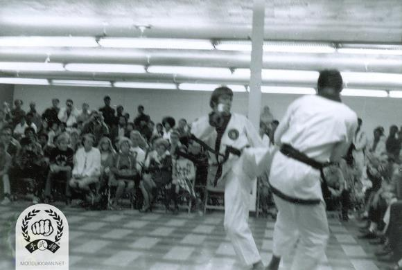 Ja Yu Dae Ryun Shim Sa at the 46th Dan classing on September 27, 1970 in Detroit, Michigan. Chuck Norris (2819) is shown (facing forward) and Loren Adams (12941) is shown (facing backward).