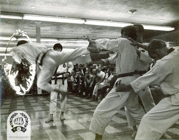 E Dan Yup Podo Cha Gi demonstration through fire ring during the 46th Dan classing Shim Sa on 1970, Detroit, Michigan.