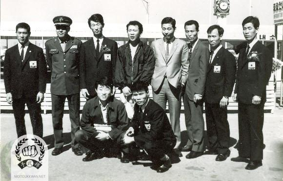 The Korean team for the 1st World Karate Union which was held in Tokyo, Japan. Chun Sik Kim (2457), Col. Han, Hong Rae Kim ( ), H.C. Hwang(509), Kang Uk Lee(70) in standing and Boem Ju Lee (11870) and Duk Soo Choi (3682 ) in sitting are shown in this photo.