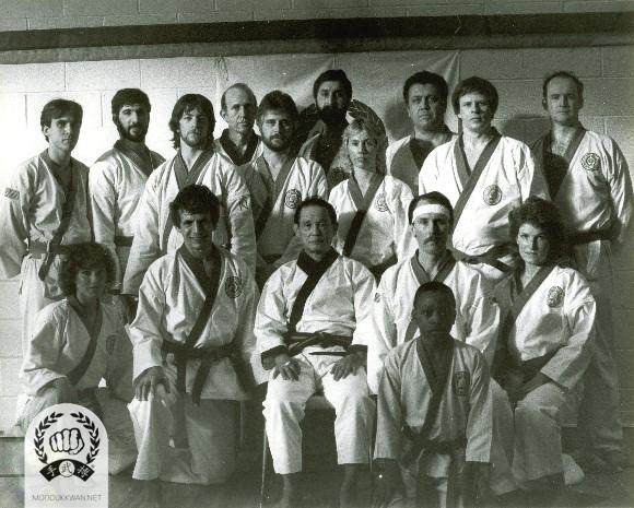 The founder's first Chil Song Hyung clinic to members at the Westfield YMCA, NJ in early 1984. Standing from left: Thomas Rocca (25023), Ken DeVos (26017), David Flick (26018), Sam Maxwell (22916), Terrance Brennan (25022), Jack Helfgott (26104), Elizabeth Kreitler (25016), John DiFiore (23709), William Weber (23641), Unknown. Seating from left: April Pampalone (26929), Nelson Abanto (), Founder, Ed Faherty, Jamal Wright (25020), and Gloria Ruby (26456).