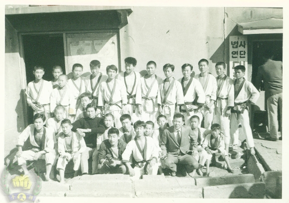 MDK headquaters Do Jang in 1970. HC Hwang(509), Song Gil Lee (8875), and Beom Ju Lee (11870) are shown in this photo with students.